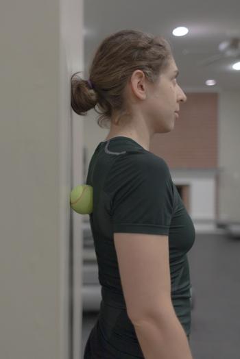 Pin tennis ball between back and wall
