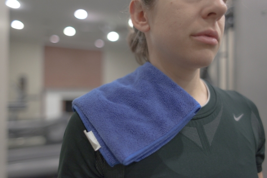 Towel over shoulder for padding
